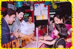Mr. Suman distributing free game tokens to the guests, click here to see large picture.